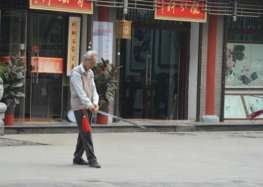 old man learning Chinese sword