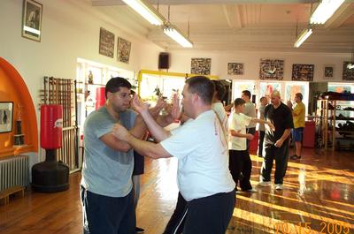 Sifu Bruce assisting Master Cama during a seminar in NYC