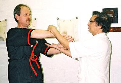 Grandmaster Leung Ting (right) and Sifu Keith Sonnenberg (left) in chi sau pose.