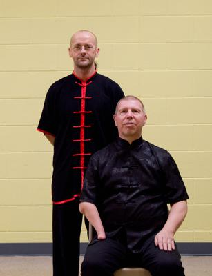 Instructor Kristian Gordon with Sifu/Master Mark Beardsell(seated)